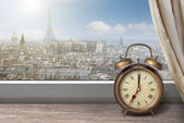 View of Paris and Eiffel tower from window with alarm clock — Stock Photo