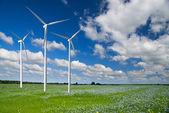 Wind generator turbine on spring landscape — Stok fotoğraf