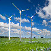 Wind generator turbine on spring landscape — Stock Photo