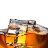 Close up splash of whiskey with ice isolated on white — Stock Photo