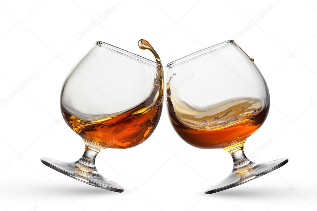 http://st.depositphotos.com/1001686/4333/i/950/depositphotos_43330349-Splash-of-cognac-in-two-glasses-isolated-on-white-background.jpg