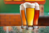 Different beer in glasses in pub — Stock Photo