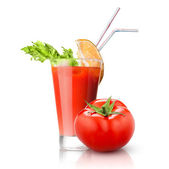 Red tomato and glass of juice isolated on white — Stock Photo