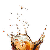 Splash of cola in glass isolated on white — Stock Photo