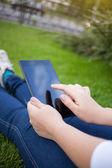 Woman using digital tablet PC — Stock Photo
