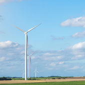Wind generators turbines on summer landscape — Stock Photo
