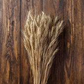Wheat on wood — Stock Photo