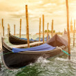 Gondolas on sunset, Grand Canal in Venice — Stock Photo #50986709