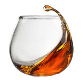Splash of cognac in glass isolated on white — Stock Photo