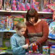 The boy in shop with toys — Stock Photo