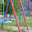 Stok fotoğraf: Children's swing in yard