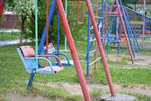Children's swing in a yard — Stock Photo