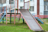 Empty children's hills in a house yard — Stock Photo