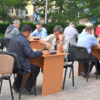 Stock Photo: Street tournament on chess on holiday day of athlete. Tyum