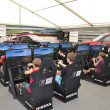 Teenagers drive simulators of racing game at the Nismo G-Drive S — Stock Photo