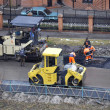 Stock Photo: Special equipment on repair of roads. Bulldozer, asphalt spreade