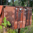 Old rusty mailboxes on the street in the village — Stock Photo