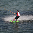 Stock Photo: Athlete of water skiing on water ski