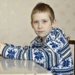 10-year-old boy sits with textbook, doing homework. — Zdjęcie stockowe #39550489