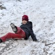 The teenage boy rides from a hill in the snow-covered wood. — Stock Photo #39856859