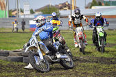Cross-country race. Motorcyclists on motorcycles enter turn. — Stock Photo