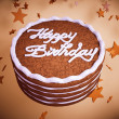 Happy birthday: cake with colorful background and stars — Stock Photo