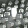 New idea or invention: illuminated efficient bulb among old ones — Stock Photo