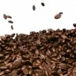 Stock Video: Coffee beans mixing and tossing up with slow motion