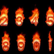 Stock Video: Loopable burning 0, 1, 2, 3, 4, 5, 6, 7, 8, 9.