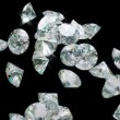 Large diamonds falling with slow motion. - Stock Photo