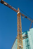 Construction site: crane and unfinished buiding — Stok fotoğraf
