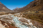 Village and drained river in Himalaya — Stock Photo
