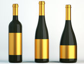 Three black bottles for wine with golden labels — Stock Photo