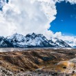 Panoramic view on the mountain peaks and glacier near Everest ba - Stock Photo