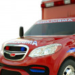 Stock Photo: Ambulance: Closeup view of emergency services vehicle on white