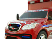 Ambulance: Closeup view of emergency services vehicle on white — Stock Photo