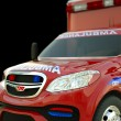 Stock Photo: Ambulance: Closeup view of emergency services vehicle on black