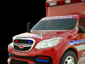 Ambulance: Closeup view of emergency services vehicle on black — Stock Photo