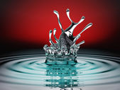 Blue colorful fluid splash and ripples over red — Stock Photo
