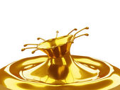 Melted Gold: liquid metal splashes isolated — Stock Photo