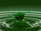 Splash of colorful green fluid with droplets and waves — Stock Photo