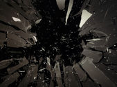 Destructed or shattered glass isolated on black — Stock Photo