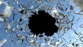 Bullet hole and pieces of glass — Stock Photo
