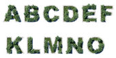Trees and grass in the form of letters — Stock Photo