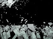 Pieces of Broken or Shattered glass isolated on black — Stock Photo