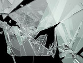 Pieces of demolished or Shattered glass isolated — Stock Photo