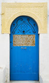Blue door with ornament — Stock Photo