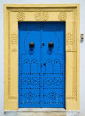 Blue door with ornament — 图库照片
