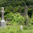 Celtic cross at a graveyard - Stock Photo
