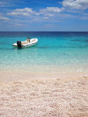 Private beach with speedboat — Photo